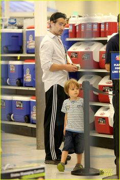 Colin Farrell gets snacks at a Rite Aid store with his son Henry on June 14, 2013