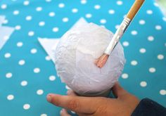 Great project for kids.....unbreakable ornaments that look like paper mache, but are really just tissue paper applied to styrofoam balls and decorated....great idea from fiskars.com  #trendytree