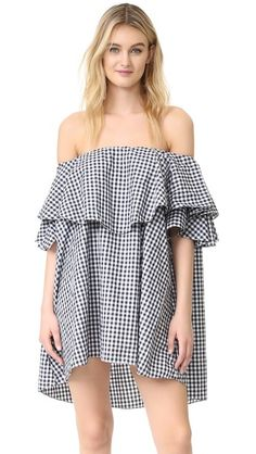 An over-sized MLM LABEL off-shoulder dress styled with layered ruffles.