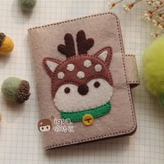 i like the little pocket book idea, either as a wallet, business card holder, notepad or needle book.