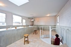 Extraordinary Contemporary Home Design in Japan: Spiral Staircase Connect The Firts Floor To The Kitchen That Has Long Island In K House Wit. Interior Design Kitchen, Bathroom Interior, Osaka, Blog Design Inspiration, Wooden Stools, Concrete Design, Interior Architecture, House Design, Flooring