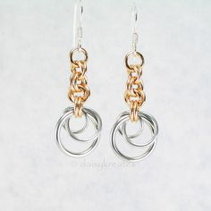 """Classic silver and gold tones Tea Rose earrings with a hint of regal flair. Hand woven in my original design of stylized rose buds, each silver tone Tea Rose hangs under a short chain of jewelry brass """"stem"""" in gentle criss cross pattern, together with the open, airy rose motif, each earring weighs at half ounce, ideal for everyday use."""