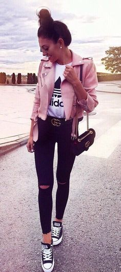 cool street style / pink moto jacket + printed top + rips + bag + converse