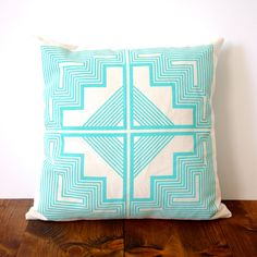 Aztec Quilt Pillow Cover. A great way to add color into a bedroom or living room. #pillow #geometric #fun dotandbo.com