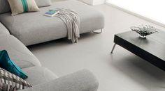 Design tiles Softline Charcoal in a living room. Amtico Spacia, Amtico Flooring, Vinyl Flooring Kitchen, Living Room Flooring, Corporate Interiors, Tile Design, Tiles, Ottoman, Lounge