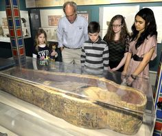 From left to right: Tech Valley High School students Beth Gannon, Bill Gannon, Liana Pondillo and Rokey Sultana, join Egyptologist Dr. Bob Brier, second from left, to examine one of the Albany Mummies at the Albany Institute of History and Art Thursday. (Mike McMahon/The Record)