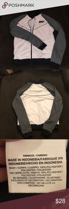 New Women's Nike Track Jacket Size Medium Brand new track jacket. Colors consist of gray, black, and white. It does fully zip. 100% Polyester Nike Jackets & Coats