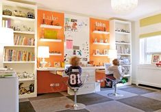 Orange is a great backdrop separating these white bookshelves which give the room an organized feel.  These are the coolest desk chairs ever. Carpet tiles are great for kids spaces for ease of cleaning.  Read the Blog at: http://www.aesthetedesigns.com/blog/ Aesthete Designs - Become a fan at:goo.gl/U6zPw