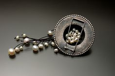 Lynette Andreasen - mokume1    brooch in sterling silver, mokume gane of nickel and copper, pearls, and silk