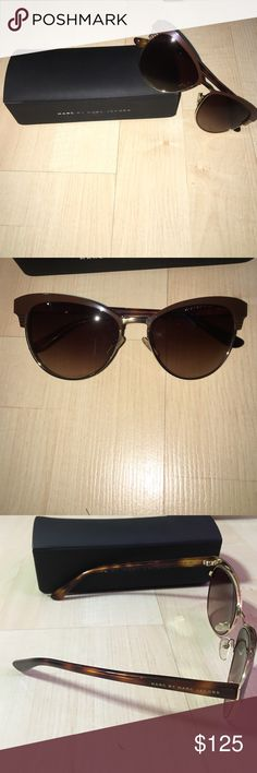 AUTHENTIC Marc Jacobs brown cat eye sunglasses These fashionable brown & gold cat eye sunnies are the perfect sunglasses!! They have barely been used so they are in great condition & include the box & the cleaning rag. No trades, open to offers! Marc by Marc Jacobs Accessories Sunglasses