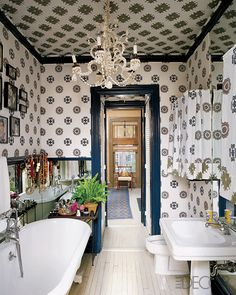 Bathroom in Muriel Brandolini's New York townhouse. Combines classic fixtures with a painted floor, navy woodwork, and hand-blocked printed fabric by Brandolini.