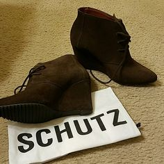 Schutz Wedge Bootie Pre-owned booties with slight wear to the back heels. Mostly where my jeans fell. These are unique and a great pair of shoes with a 3.5 inch wedge. These are suede. SCHUTZ Shoes Wedges