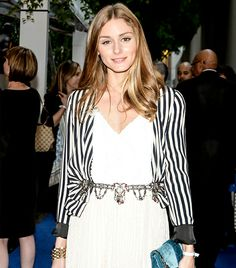 Olivia Palermo: Punctuate pretty cocktail separates, like a blazer and pleated skirt, with a jeweled belt.  On Olivia: Zara jacket and belt; Tibi top; Christian Dior clutch.