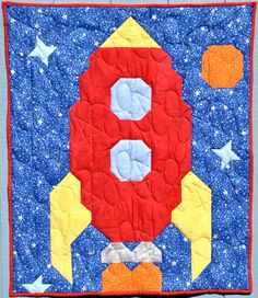 Blast off to out space, and wish on the stars as you go to sleep under this Rocket Quilt.  Patterns available at www.countedquilts.com
