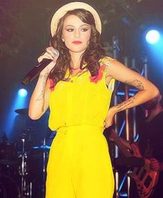 Cher on stage with a bright yellow dress :) x