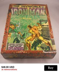 Simple and clean design - deco-page finish with scenes from Marvel Iron Man comic books. The box is handmade from an upcycled cigar box and old comic books. The box is unique and one-of-a-kind. Makes a great gift for the comic book lover or environmentalist. Look for our handmade upcycled comic book jewelry if you want to make it into a gift box.  The measurements for this box are 1 3/4h x 6 1/2w x 9L x 1 1/4 depth in inches.
