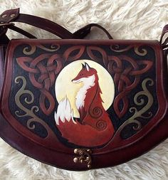 Hand tooled, embossed artwork with animals such as Fox, Hare, Stag designs. Celtic knotwork, oak leaf and tribal. Leather Art, Leather Tooling, Costume Bags, Costumes, Art Fox, Stag Design, Fox Bag, Fox Purse, Fru Fru