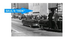 """*PHOTO BY:ROBERT ALTGENS~shows the pres.car before it turned lt.onto""""death alley"""".The Dal-Tex Bldg.where Abraham Zapruder worked is the forward,grey bldg.Note the 4 windows above JFK on the lighter colored bldg.to the rt.of the car?  The shooter was in the first rm. from the corner,2flrs.up+hiding deeply in the room.This gave him a low trajectory fromJFK's lt.rear once the car had turned+this put Gov.Connelly in the direct line of fire,too."""