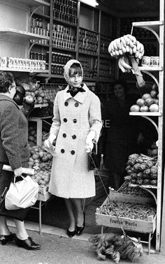 Audrey Hepburn photographed by Elio Sorci while shopping at a grocery store in Rome, Italy, November 1961.