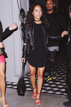 Karrueche. a black shirt dress and red heels