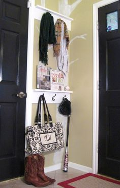 Small entry ideas///My entry is super small and this is a great organization idea. I love this double coat hook idea. Guests can hang their coats and bags. You can also hang things that you need take with you as you go out the door.RH