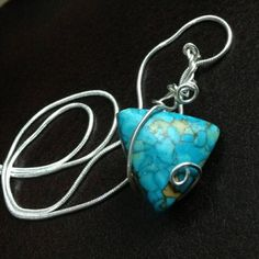 This rare blue Indian turquoise stone pendant is wrapped in sterling silver. It is so rare to find one of the kind pieces like this because this kind of turquoise has only ever heard of, but never seen by most people I was able to get my hands on this gorgeous stone and I only have a few turquoise stones left I wrap each sterling silver and make it so stunning and unique this is a must have people love to request a piece of our history is held within the million year old stones.