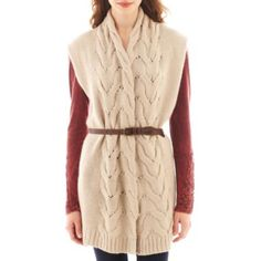 """<p>A faux-leather belt lassos our spirited, open-front cable knit sweater vest.</p><div style=""""page-break-after: always;""""><span style=""""display: none;"""">"""