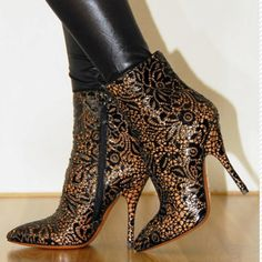 Alaia.  Maybe pin an applique or brooch onto Ann Taylor boots.
