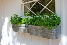 Hang galvanized tubs with L brackets on front or back porch