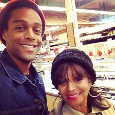 Austin Brown with his mom Rebbie Jackson sharing their love for hats. (2012)
