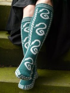 """The socks are knitted in the round using stranded technique on 2.5mm/US1½ needles at a tension of 44 rounds and 32 stitches to 10cm/4"""". The socks may be knitted on a variety of needle types according to the knitter's preferred technique for sock knitting, either DPNs, two circulars, or one long circular for magic loop."""