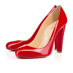 """Fififa"" makes her debut this Spring/Summer season.  A descendant of our illustrious ""Fifi,"" she is a striking new silhouette that combines the gentle, round toe with a strong, wide 100mm heel. Perfect for any occasion in signature red patent leather, she helps you journey from daytime to evening in first-class comfort."