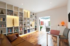Granit Architects Pelham Road, Wimbledon Living room, bespoke shelving, LED strip lighting, timber flooring