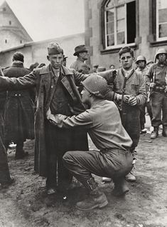 A young German boy searches the American Soldier (1945)