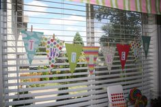 Banner made out of scrapbooking paper, yarn and clothes pins.