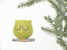 Are you ready for the sweetest Christmas ornament around? This needle felted owl has been handmade from the softest, purest wool and is sure to make
