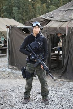 Airsoft Player in Japan. Fashion Photo. Columbia vest. Military. Gun. Combat