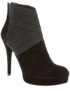 This black and grey suede ankle boot from Stuart Weitzman features a grey weaved ankle panel, round toe, high heel and platform.  Gorgeous!