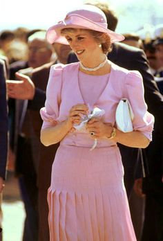 Prince Charles Princess Diana in Sicily, Italy 1985. Her pink ensemble is by Catherine Walker. Her hat by John Boyd.