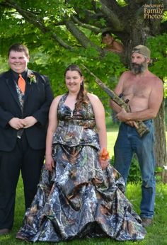 Oh there's nothing like showing your love of hunting through your custom made camo dress and dad holding a rifle.