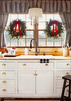 I love wreaths with red bows and putting them inside the windows.