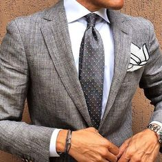 Classic. Grey suit. Grey polka dot tie. Handkerchief on point.