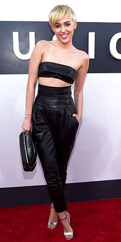 The Good, Bad & Boldest Looks of the Night | MILEY CYRUS  | No hair knots this year? Miley Cyrus goes surprisingly simple in a black leather bandeau top and matching harem pants (both Alexandre Vauthier Couture), which we imagine is her version of a classic suit.