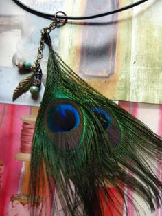 double peacock with czech glass beads... antique brass findings on black cord...