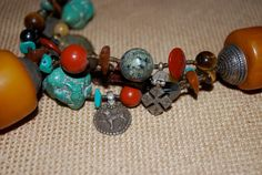 Chunky Amber and Turquoise Necklace with Antique Guatemalan Milagros, Kirdi Brass Charms.