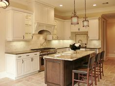 pretty two-toned kitchen, just needs hardwood floors