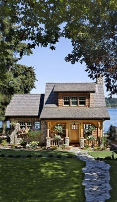 Think small! This cottage on the Puget Sound in Washington is a beautiful example of a smart cabin design.