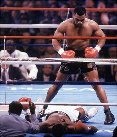 Mike Tyson standing over Michael Spinks after Knocking him out. Talk about intimidating