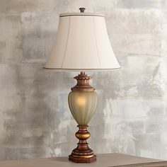 From Kathy Ireland, this nightlight table lamp features an elegant gold finish base with scalloped detailing and a bell lamp shade.