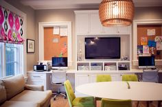 3 children's workstations were built-in near the kitchen table plus a couch study area.